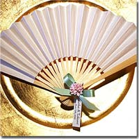 DIY Personalized Japanese Paper Fan with Ribbon and Decorative Embellishment